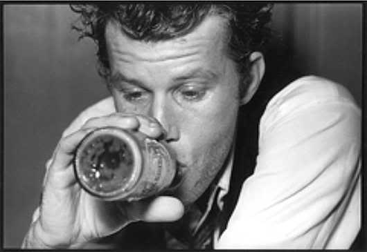 Tom Waits drinking beer