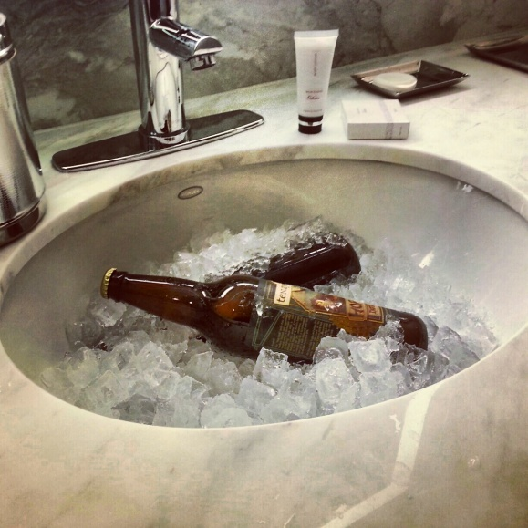 Hotel Room Sink Filled with Beer and Ice