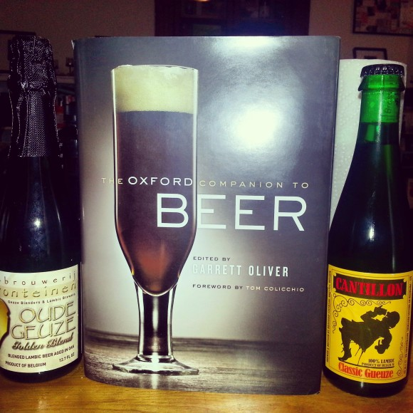 The Oxford Companion to Beer book with Cantillon and Drie Fonteinen gueuze bottles