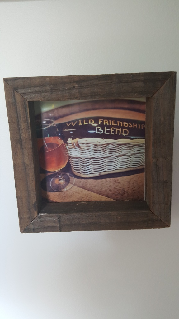 A small framed photograph of an unlabelled bottle of the Belgian Wild Friendship Blend