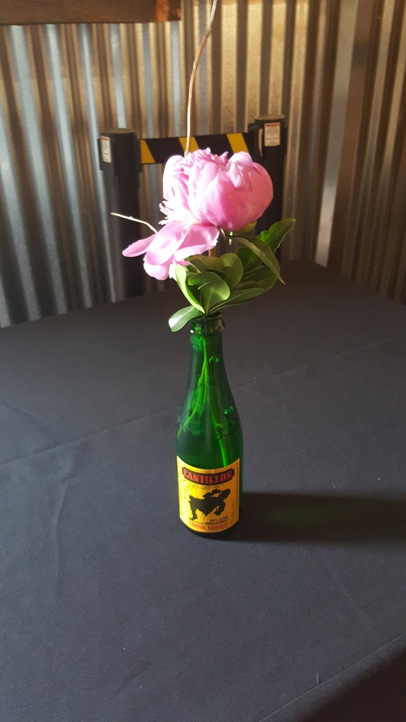 Cantillon Classic Gueuze bottles with fresh flowers were placed throughout the brewery during the Wild Friendship Celebration