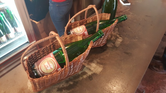 Bottles of the Belgian Wild Friendship Blend, called Assemblage de L'Amite, in lambic baskets.